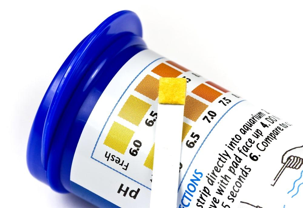 Aquarium pH strip over comparison chart
